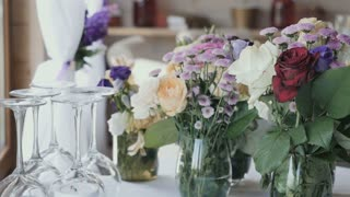 Lovely bouquets with live flowers are on the table in the restaurant