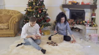 Lovely couple packs Christmas gifts