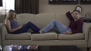 Loving couple at home on the couch
