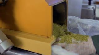 Machine put dried herbal tea into a bag