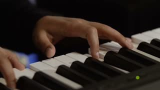 Male hands plays melody on piano