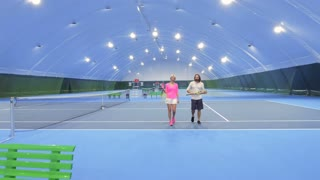 Man and woman at tennis court