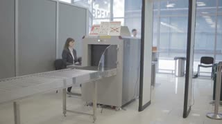 Man checks his baggage with x-ray machine in the airport
