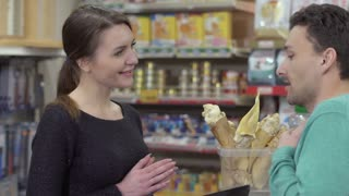 Man choose food supplement for his animals in the pet shop