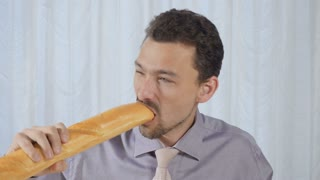 Man eats his breakfast with appetite