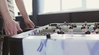 Man play table soccer