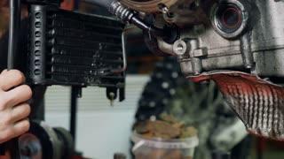 Man set the radiator in motorcycle
