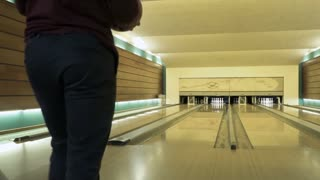 Man throws bowling ball, camera follows after the ball