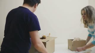 Married couple observes a room in a new house