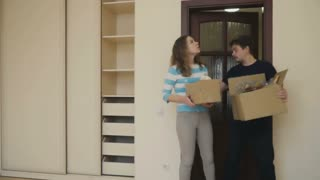 Married couple observes room in a new house