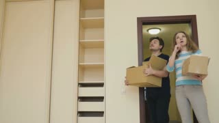 Married couple with boxes in the room of new house