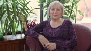 Mature woman give an interview
