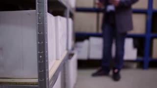 Men's feet walking on a warehouse