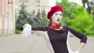 Mime girl leaned against the invisible wall