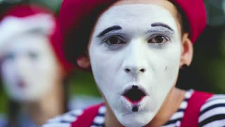 Mimes crooking face in funny ways