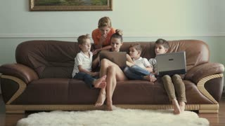 Mother with sons spends leisure time at home