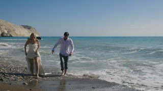 Newlyweds go on the beach after swim in ocean