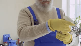 Old man read the instruction of cleaning agent