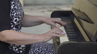 Old woman playing the piano