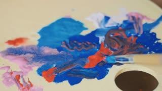 Paintbrush mix paints on the palette