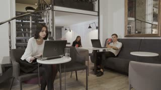 People sit at the table in the co-working space