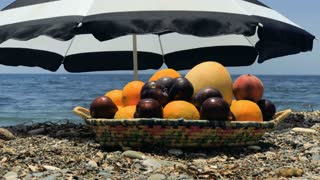 Plate with fruits at sea background