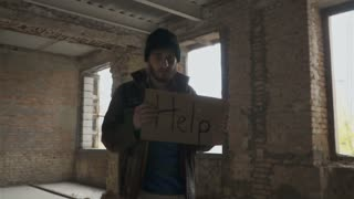 Poor dirty homeless with table 'help