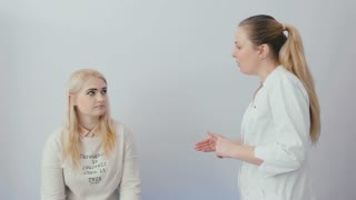 Portrait of a talking doctor with a patient
