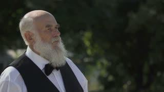 Portrait of gray-haired bearded senior man