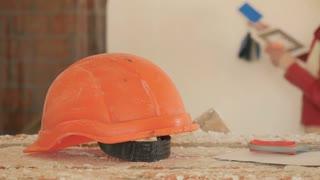 Portrait of orange protective helmet