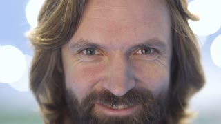 Portrait of smiling bearded adult man