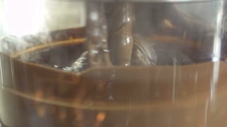 Preparing melting chocolate for dessert in machine