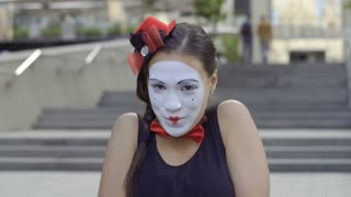 Pretty girl mime show love on camera and smiling