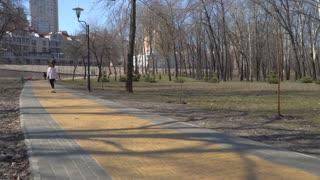 Pretty girl skateboarding in park