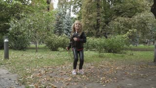 Pretty kid jumps in the park