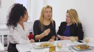 Pretty sad woman complains to her friends about her failure with boyfriend