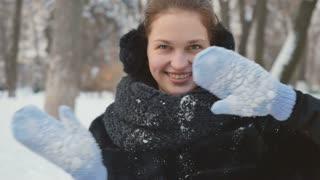 Pretty woman dances in the winter park