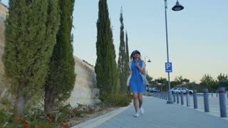 Pretty woman run at the street