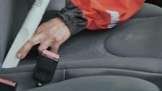 Professional cleaner vacuum the seat of car