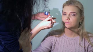 Professional make-up artist makes beautiful make-up for actress in theatre