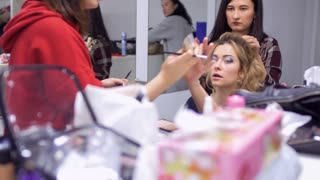 Professional stylists creates a scenic character for actress in theatre