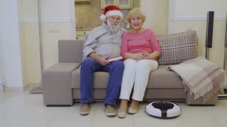 Robot vacuum cleaner cleans the home before winter holidays