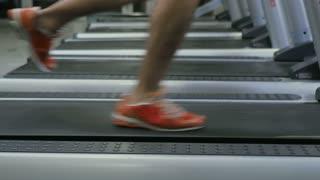 Running male legs on the treadmill