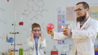 Scientist burns balloon with fire in laboratory