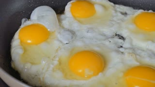 Scrumbled eggs on the frying pan