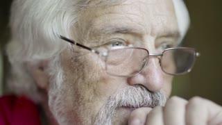 Senior gray-haired man in eyeglasses