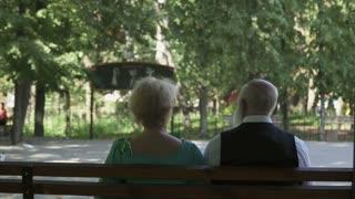 Senior in love couple dances waltz in park