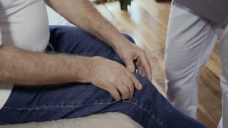 Senior man complain about his painful knee to a doctor