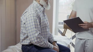 Senior man complain to doctor about pain in shoulder