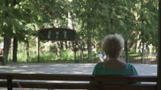 Senior man dances waltz with beautiful wife in park